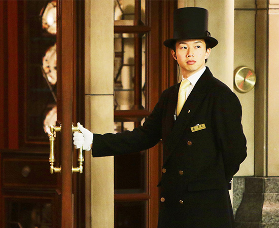 A friendly doorman welcomes guests.