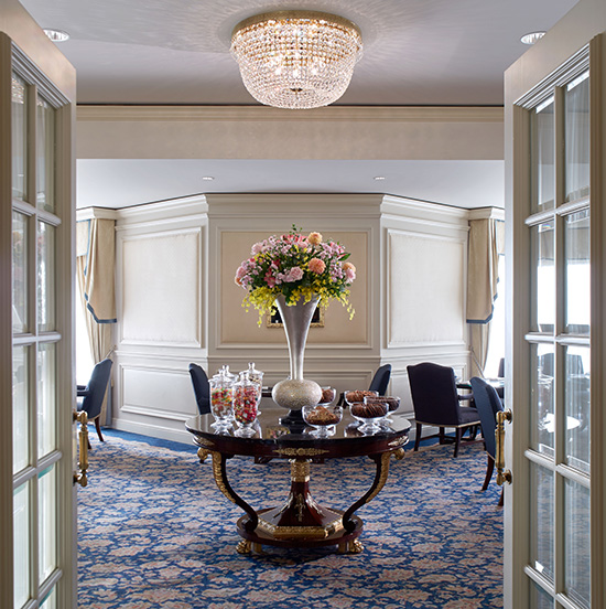 Beautiful seasonal floral arrangements greet guests at the lounge entrance.
