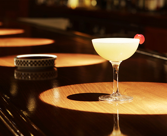 "The ""Mount Fuji,"" invented the year after the opening of the Wright Building. A beautiful gin cocktail, with an egg white imitating light snowfall."