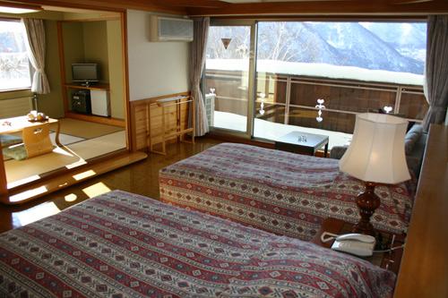 ホテルホワイトイン北志賀の客室の写真