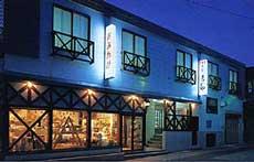 長野県野沢温泉外湯めぐりに便利な一人朝食付き7、000円くらいの駐車場有の宿を教えてください。