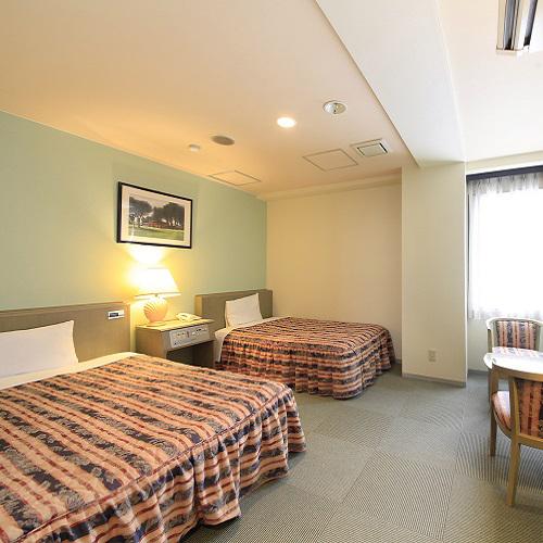 グランデュールホテルの客室の写真