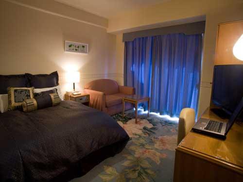 フローリスホテル ヴィラくれたけの客室の写真