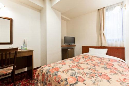 デイリーホテル朝霞駅前店の客室の写真