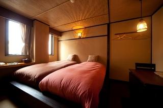 洋室(洗浄付トイレ・洗面台付)ツインのモダンなお部屋